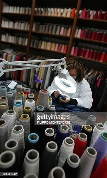DOLMADJIAN A dressmaker sews a cachemere knitwear 14 December 2007 in Italian luxury designer Brunello Cucinelli factory in the medieval hilltop...