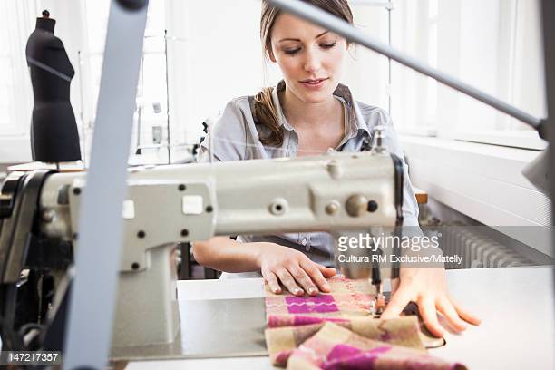 Dressmaker using sewing machine