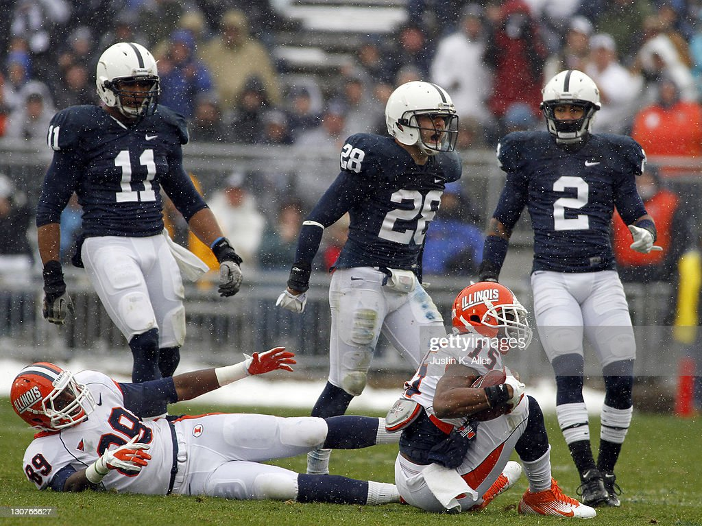 Drew Astorino #28 of the Penn State Nittany Lions celebrates after tackling Darius Millines #15 of the Illinois Fighting Illini during the game on October 29, 2011 at Beaver Stadium in State College, Pennsylvania.