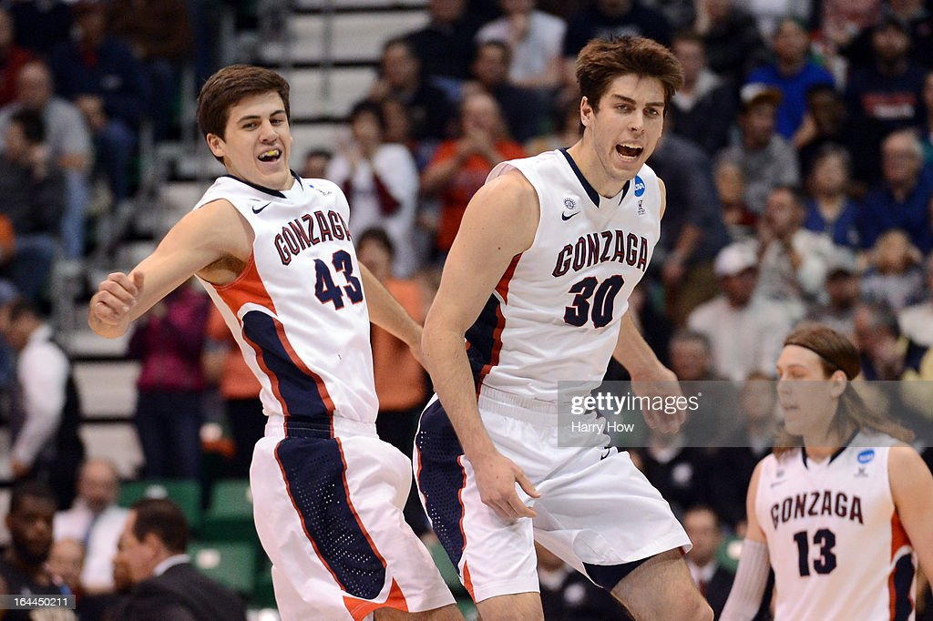 Drew Barham #43 and Mike Hart #30 of the Gonzaga Bulldogs celebrate in the second half while taking on the Wichita State Shockers during the third round of the 2013 NCAA Men's Basketball Tournament at EnergySolutions Arena on March 23, 2013 in Salt Lake City, Utah.