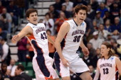 Drew Barham and Mike Hart of the Gonzaga Bulldogs celebrate in the second half while taking on the Wichita State Shockers during the third round of...