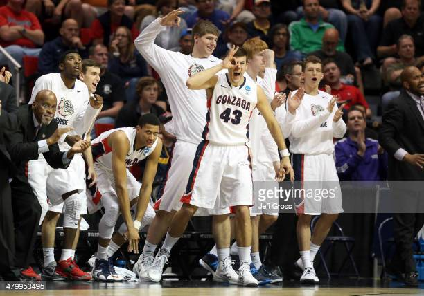 Drew Barham and other players on the bench of the Gonzaga Bulldogs cheer for their team during their game Oklahoma State Cowboys in the second round...