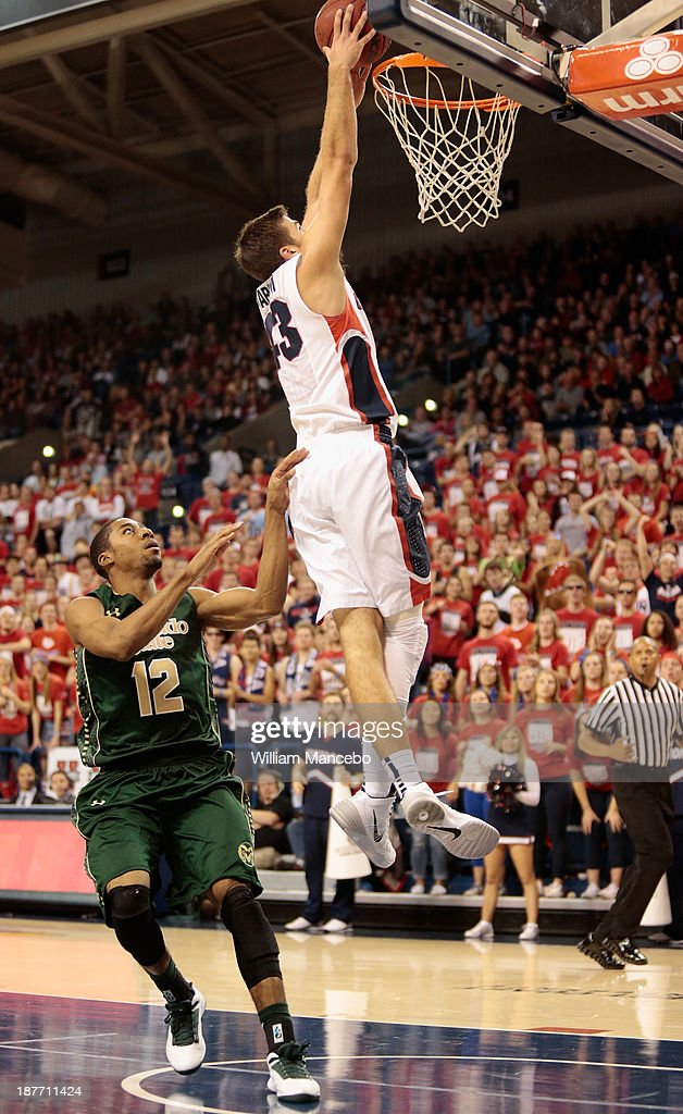 Drew Barham #43 of the Gonzaga Bulldogs goes up for the dunk against defender Carlton Hurst #12 of the Colorado State Rams during the second half of the game at McCarthey Athletic Center on November 11, 2013 in Spokane, Washington.