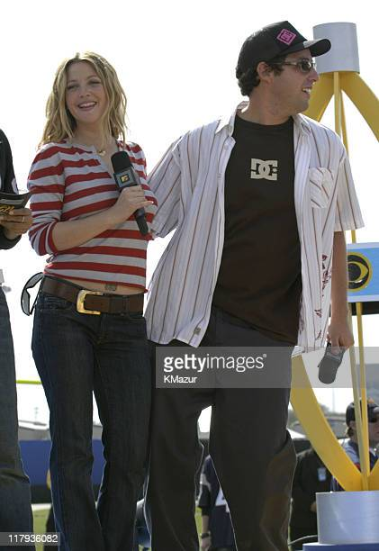 Drew Barrymore and Adam Sandler during MTV's 'TRL' at Super Bowl XXXVIII at Reliant Stadium in Houston Texas United States