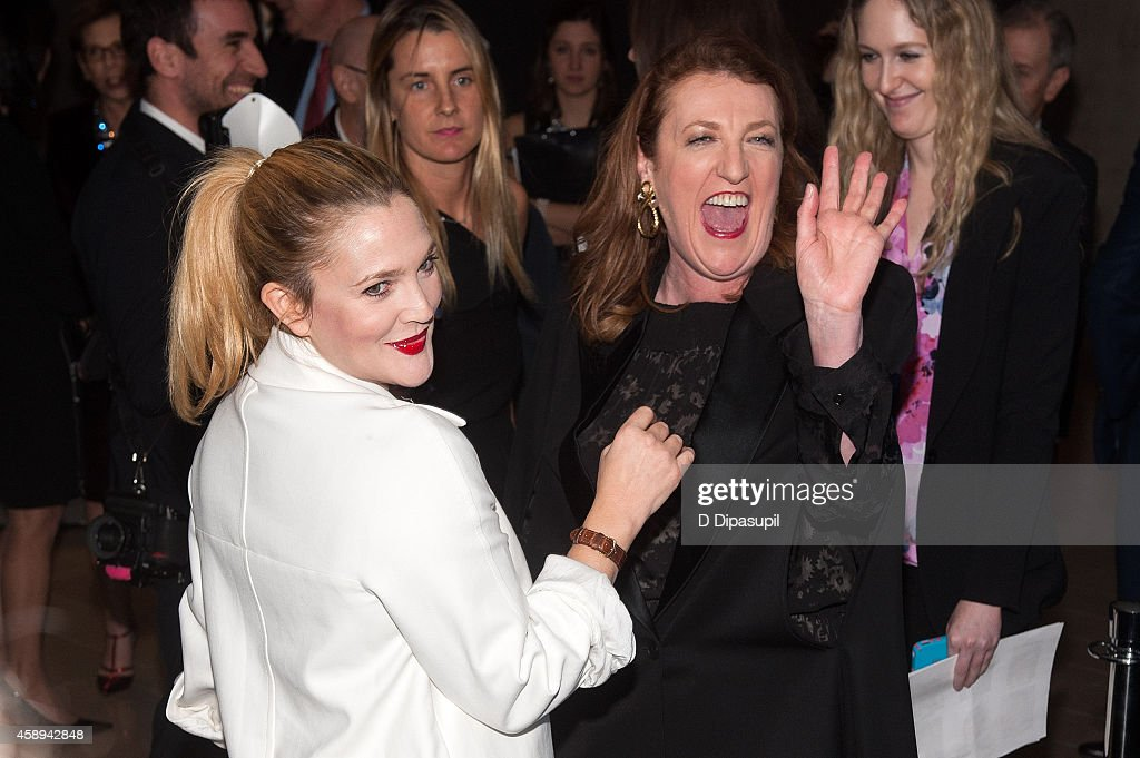 Drew Barrymore (L) and Harper's Bazaar editor-in-chief Glenda Bailey attend the 2014 Women's Leadership Award Honoring Stella McCartney at Alice Tully Hall at Lincoln Center on November 13, 2014 in New York City.