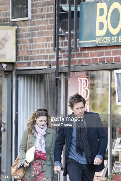 Drew Barrymore and Hugh Grant during Hugh Grant and Drew Barrymore on the Set of 'Music and Lyrics' December 6 2006 at SoHo in New York City New York...