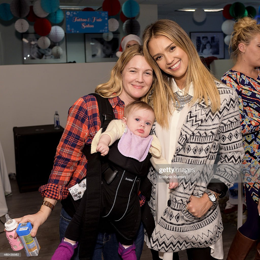 babybaby holiday party presented by the honest company photos and drew barrymore and jessica alba attend baby2baby holiday party presented by the honest company on