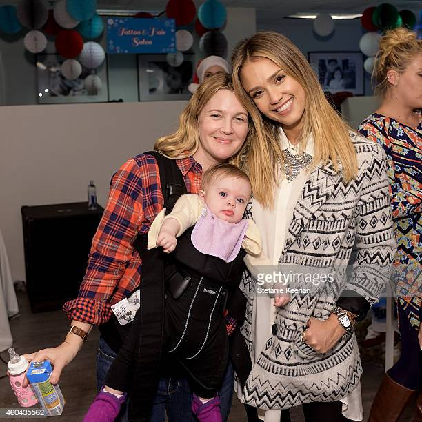 Drew Barrymore and Jessica Alba attend Baby2Baby Holiday Party Presented By The Honest Company on December 13 2014 in Los Angeles California