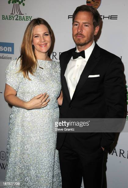 Drew Barrymore and Will Kopelman arrives at the 2nd Annual Baby2Baby Gala at The Book Bindery on November 9 2013 in Culver City California