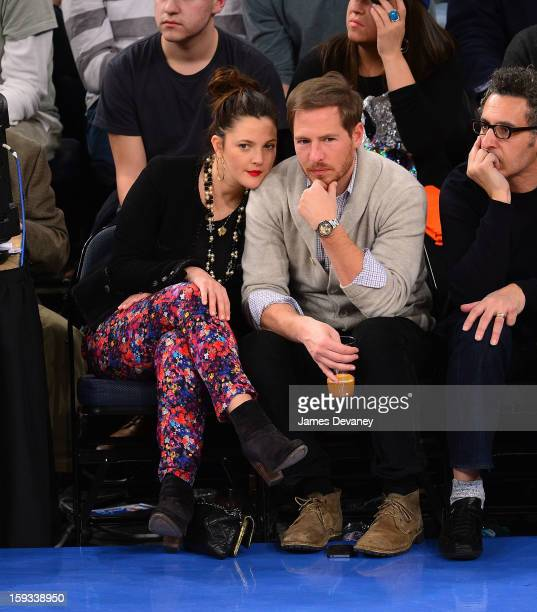 Drew Barrymore and Will Kopelman attend the Chicago Bulls vs New York Knicks game at Madison Square Garden on January 11 2013 in New York City