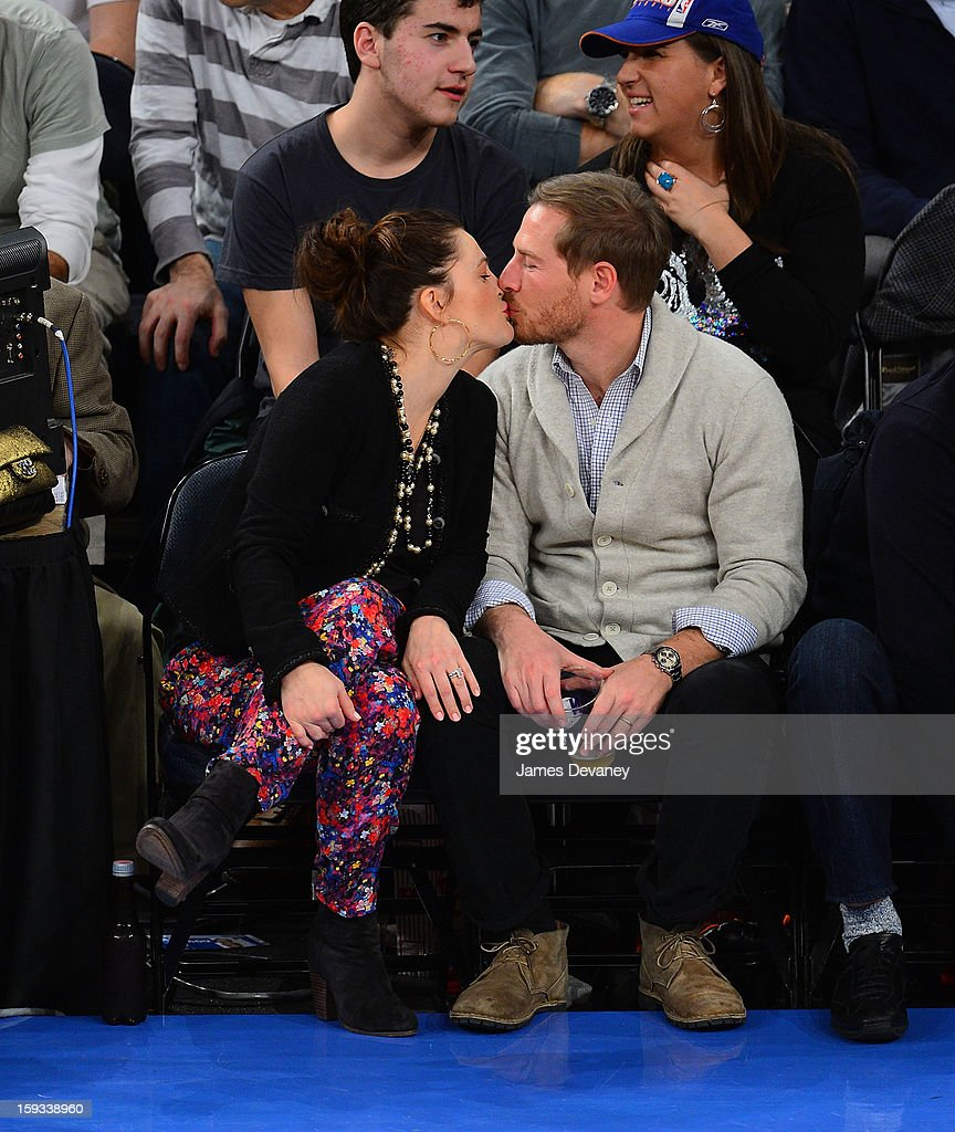 Drew Barrymore and Will Kopelman attend the Chicago Bulls vs New York Knicks game at Madison Square Garden on January 11, 2013 in New York City.