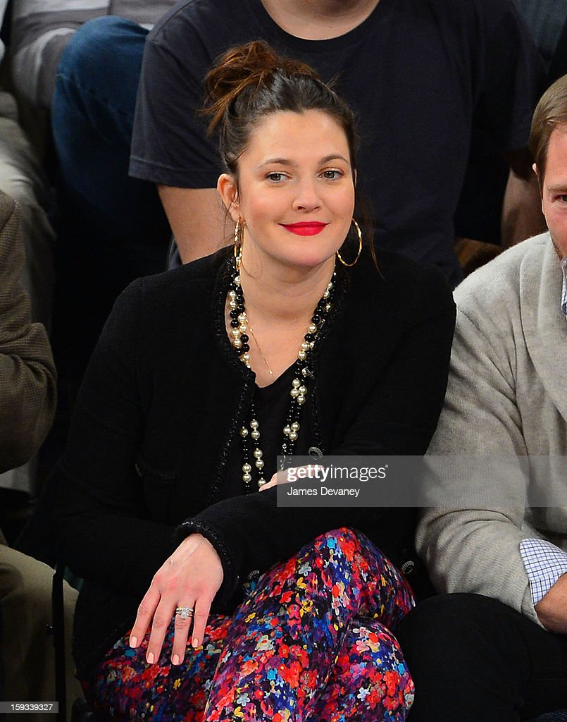 <a gi-track='captionPersonalityLinkClicked' href=/galleries/search?phrase=Drew+Barrymore&family=editorial&specificpeople=201623 ng-click='$event.stopPropagation()'>Drew Barrymore</a> attends the Chicago Bulls vs New York Knicks game at Madison Square Garden on January 11, 2013 in New York City.