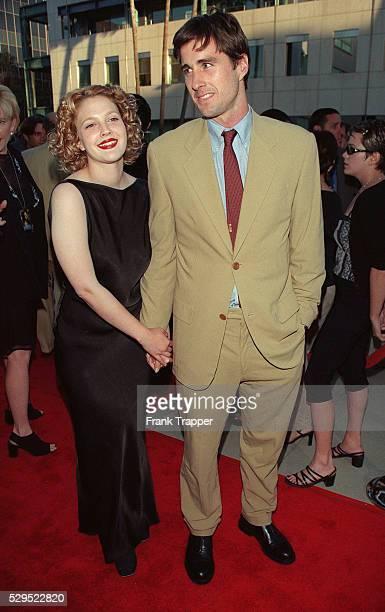 Drew Barrymore costar of the movie and her boyfriend Luke Wilson arrive