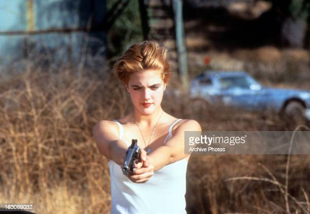 Drew Barrymore holds a gun in a scene from the film 'Guncrazy' 1992