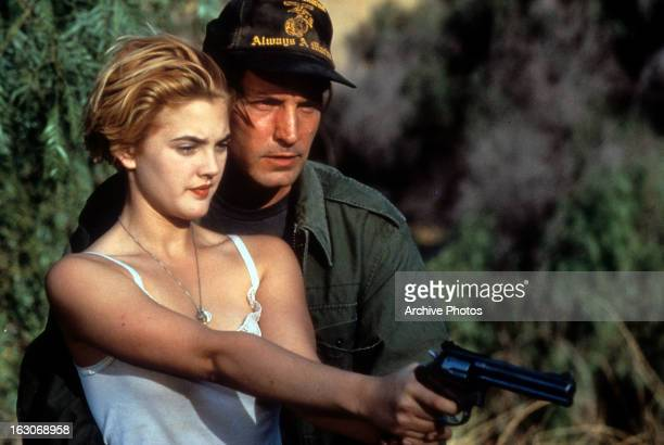 Drew Barrymore learns to shoot in a scene from the film 'Guncrazy' 1992