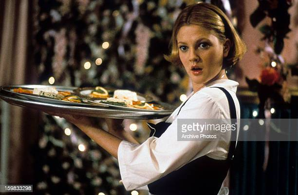 Drew Barrymore waits tables in a scene from the film 'The Wedding Singer' 1998