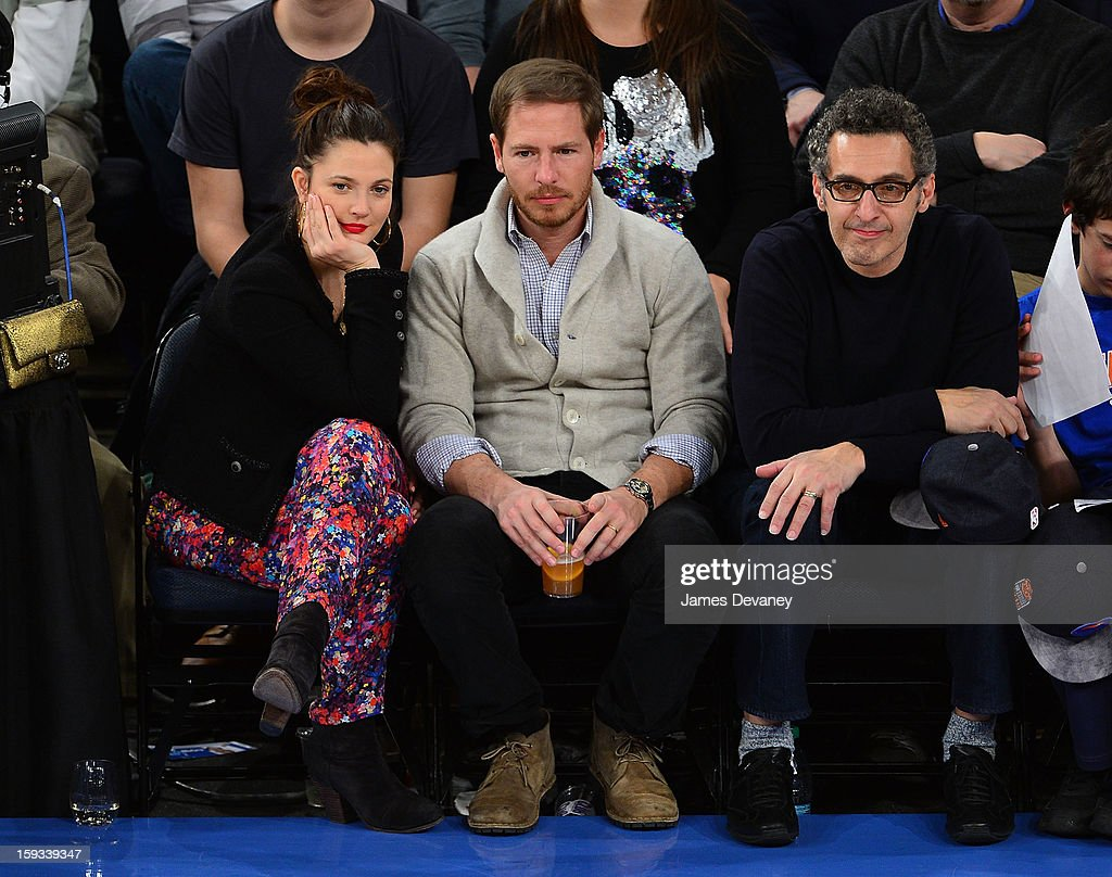 Drew Barrymore, Will Kopelman and John Turturro attend the Chicago Bulls vs New York Knicks game at Madison Square Garden on January 11, 2013 in New York City.