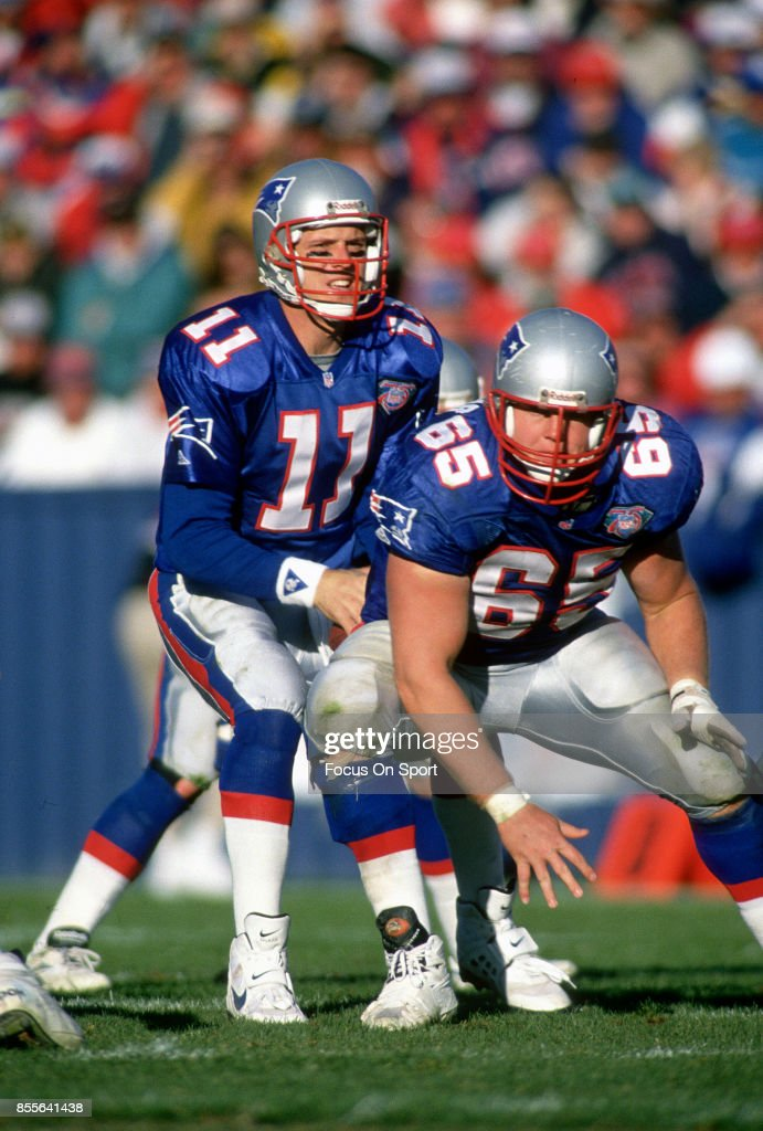718c8b55c ... Drew Bledsoe 11 and Mike Arthur 65 of the New England Patriots in  action New England Patriots Apparel ...