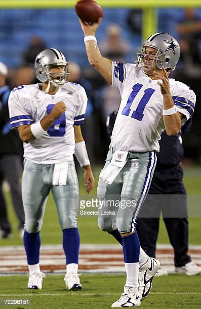 Drew Bledsoe of the Dallas Cowboys warms up in front of Tony Romo before the start of their game against the Carolina Panthers on October 29 2006 at...