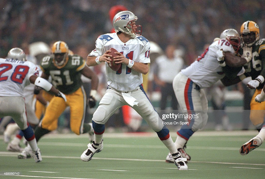 <a gi-track='captionPersonalityLinkClicked' href=/galleries/search?phrase=Drew+Bledsoe&family=editorial&specificpeople=183356 ng-click='$event.stopPropagation()'>Drew Bledsoe</a> #11 of the New England Patriots drops back to pass against the Green Bay Packers during Super Bowl XXXI January 26, 1997 at the Louisiana Superdome in New Orleans, Louisiana . The Packers won the game 35-21.
