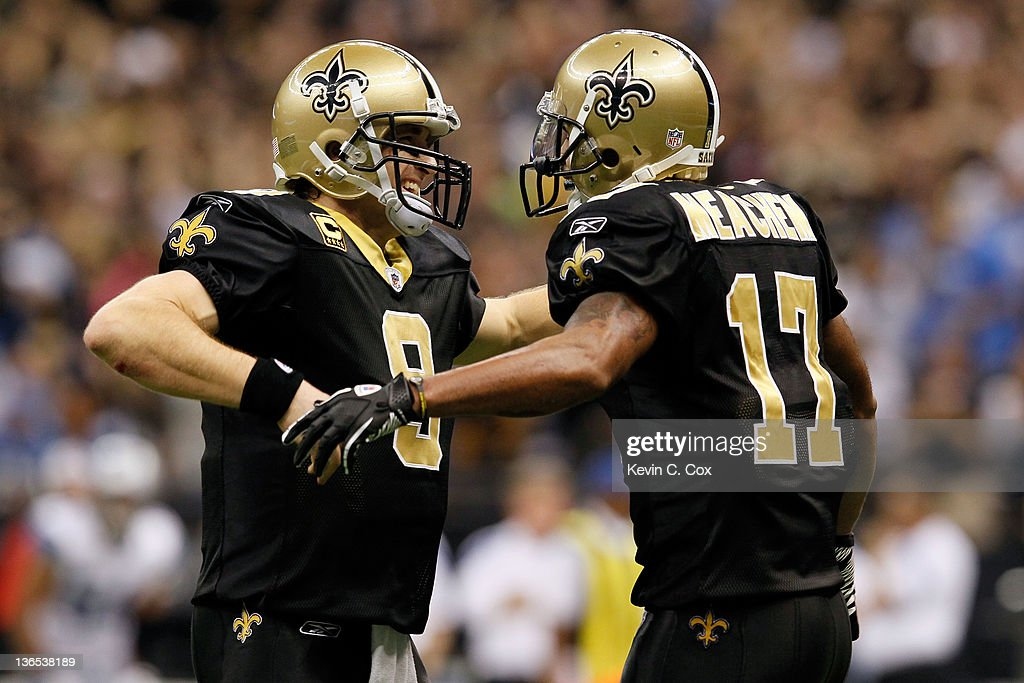 <a gi-track='captionPersonalityLinkClicked' href=/galleries/search?phrase=Drew+Brees&family=editorial&specificpeople=202562 ng-click='$event.stopPropagation()'>Drew Brees</a> #9 and <a gi-track='captionPersonalityLinkClicked' href=/galleries/search?phrase=Robert+Meachem&family=editorial&specificpeople=2128641 ng-click='$event.stopPropagation()'>Robert Meachem</a> #17 of the New Orleans Saints celebrate after their touchdown in the fourth quarter against the Detroit Lions during their 2012 NFC Wild Card Playoff game at Mercedes-Benz Superdome on January 7, 2012 in New Orleans, Louisiana.
