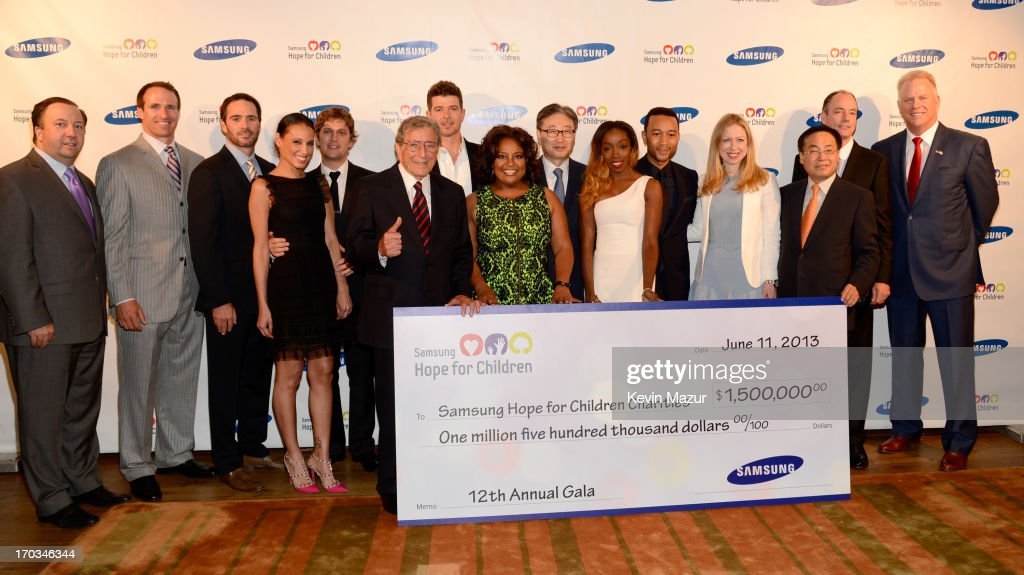 Drew Brees, Jimmie Johnson, Marisol Thomas, Rob Thomas, Tony Bennett, Robin Thicke, Sherri Shepard, BK Yoon, Estelle, John Legend, Chelsea Clinton, CEO of Samsung Electronics America YK Kim, president of Samsung Electronics America Tim Baxter and Boomer Esiason attend the Samsung's Annual Hope for Children Gala at CiprianiÕs in Wall Street on June 11, 2013 in New York City.