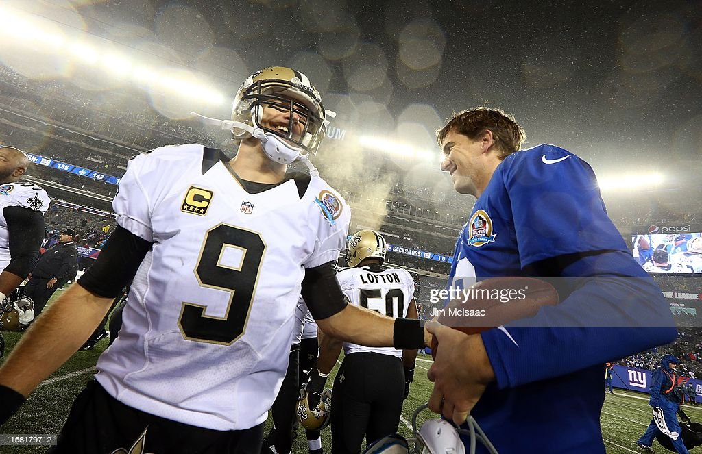 Drew Brees #9 of the New Orleans Saints and Eli Manning #10 of the New York Giants meet after their game at MetLife Stadium on December 9, 2012 in East Rutherford, New Jersey. The Giants defeated the Saints 52-27.