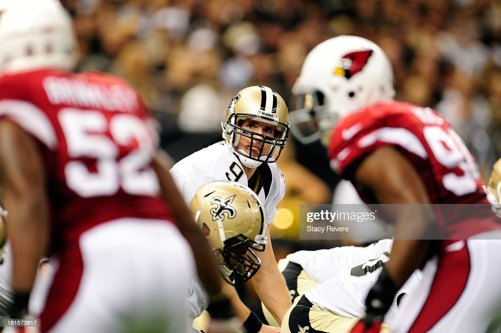 Drew Brees #9 of the New Orleans Saints calls a play at the line during a game against the Arizona Cardinals at the Mercedes-Benz Superdome on September 22, 2013 in New Orleans, Louisiana. The Saints defeated the Cardinals 31-7.