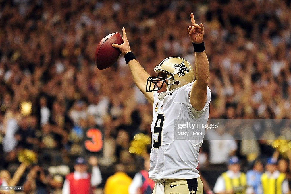 Drew Brees #9 of the New Orleans Saints celebrates a touchdown against the Arizona Cardinals during a game at the Mercedes-Benz Superdome on September 22, 2013 in New Orleans, Louisiana. The Saints defeated the Cardinals 31-7.