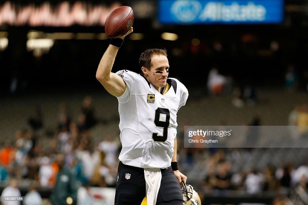 <a gi-track='captionPersonalityLinkClicked' href=/galleries/search?phrase=Drew+Brees&family=editorial&specificpeople=202562 ng-click='$event.stopPropagation()'>Drew Brees</a> #9 of the New Orleans Saints celebrates after defeating the Miami Dolphins 38-17 at the Mercedes-Benz Superdome on September 30, 2013 in New Orleans, Louisiana.