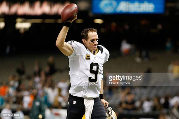 Drew Brees of the New Orleans Saints celebrates after defeating the Miami Dolphins 3817 at the MercedesBenz Superdome on September 30 2013 in New...