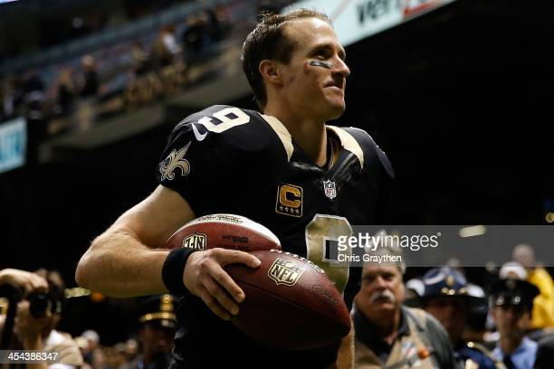 Drew Brees of the New Orleans Saints celebrates after defeating the Carolina Panthers at MercedesBenz Superdome on December 8 2013 in New Orleans...