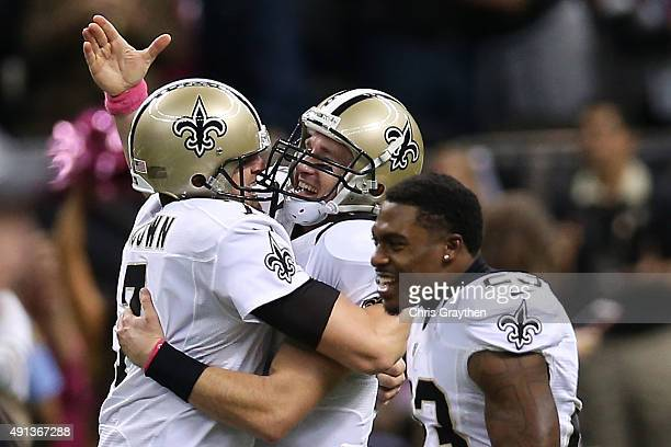 Drew Brees of the New Orleans Saints celebrates after throwing his 400th touchdown pass to CJ Spiller of the New Orleans Saints in overtime to defeat...