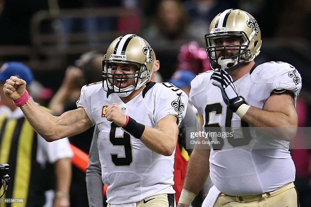Drew Brees #9 of the New Orleans Saints celebrates after throwing his 400th touchdown pass to C.J. Spiller #28 of the New Orleans Saints in overtime to defeat the Dallas Cowboys 26-20 at Mercedes-Benz Superdome on October 4, 2015 in New Orleans, Louisiana.