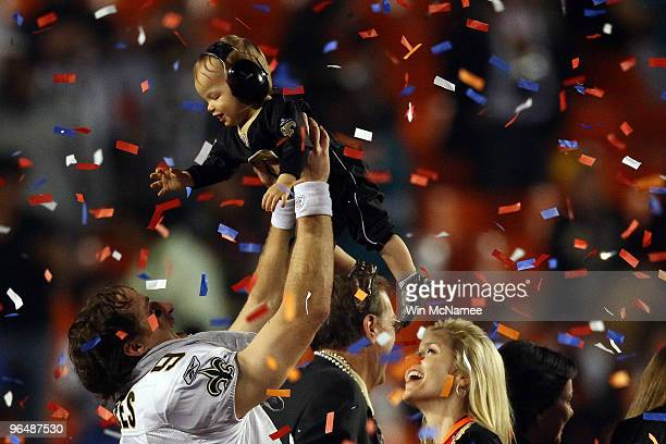 Drew Brees of the New Orleans Saints celebrates with his son Baylen Brees as his wife Brittany Brees looks on after defeating the Indianapolis Colts...
