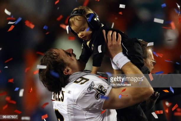 Drew Brees of the New Orleans Saints celebrates with his son Baylen Brees after defeating the Indianapolis Colts during Super Bowl XLIV on February 7...
