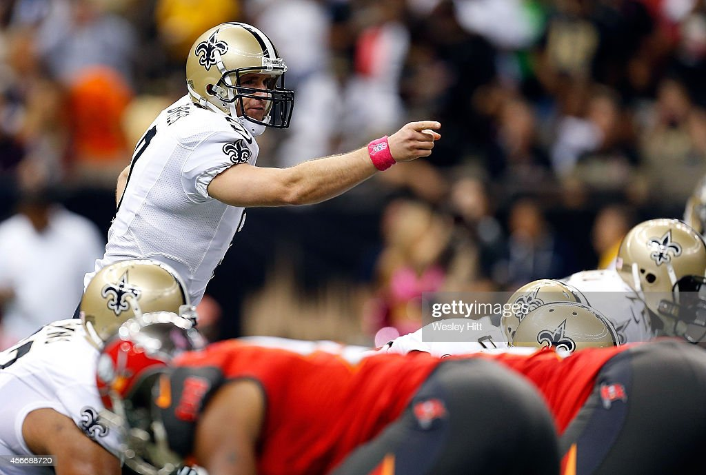 Drew Brees #9 of the New Orleans Saints directs his team during the first quarter of a game against the Tampa Bay Buccaneers at the Mercedes-Benz Superdome on October 5, 2014 in New Orleans, Louisiana.