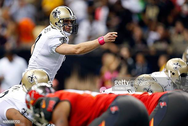 Drew Brees of the New Orleans Saints directs his team during the first quarter of a game against the Tampa Bay Buccaneers at the MercedesBenz...