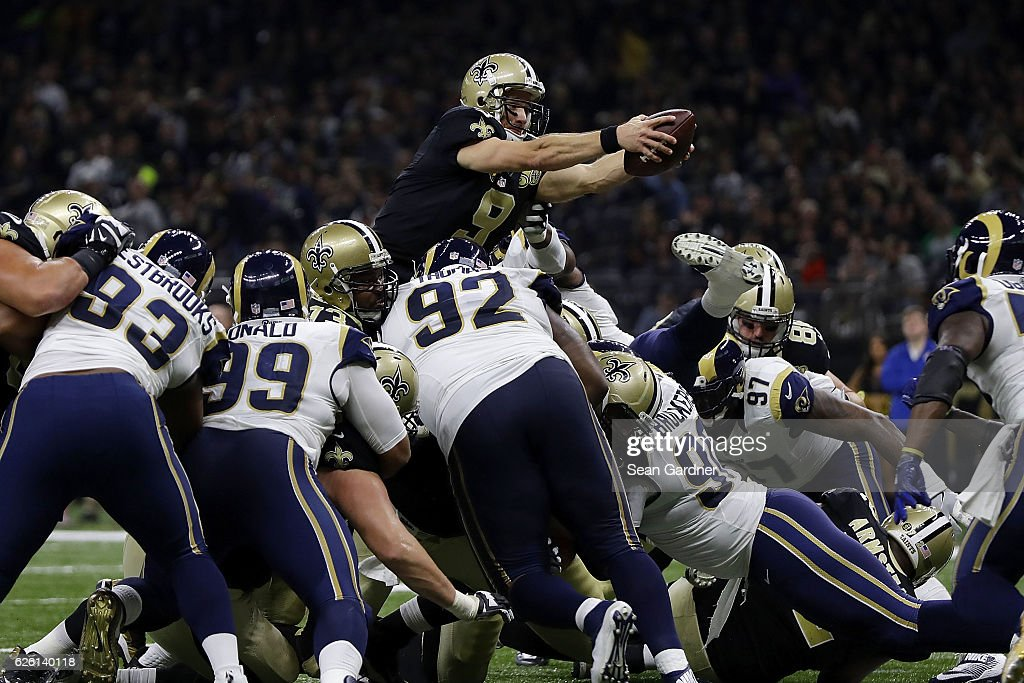 Drew Brees #9 of the New Orleans Saints drives for a touchdown during the first half of a game against the Los Angeles Rams at the Mercedes-Benz Superdome on November 27, 2016 in New Orleans, Louisiana.