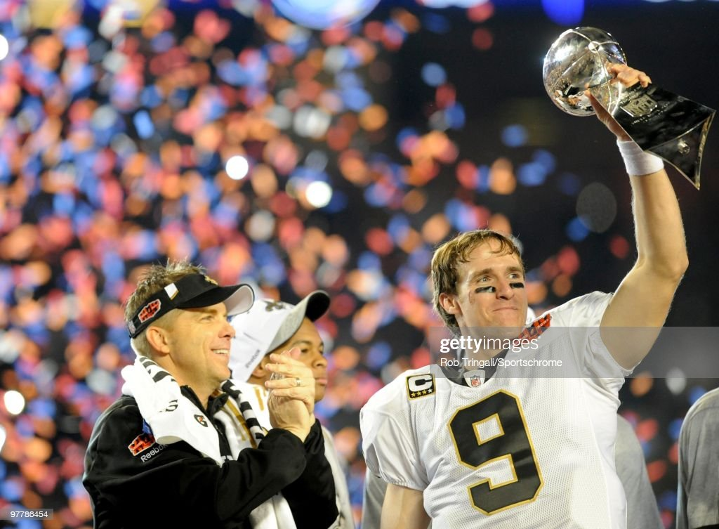 <a gi-track='captionPersonalityLinkClicked' href=/galleries/search?phrase=Drew+Brees&family=editorial&specificpeople=202562 ng-click='$event.stopPropagation()'>Drew Brees</a> #9 of the New Orleans Saints holds up the Vince Lombardi Trophy on the podium as head coach <a gi-track='captionPersonalityLinkClicked' href=/galleries/search?phrase=Sean+Payton&family=editorial&specificpeople=662200 ng-click='$event.stopPropagation()'>Sean Payton</a> looks on after defeating the Indianapolis Colts in Super Bowl XLIV on February 7, 2010 at Sun Life Stadium in Miami Gardens, Florida.
