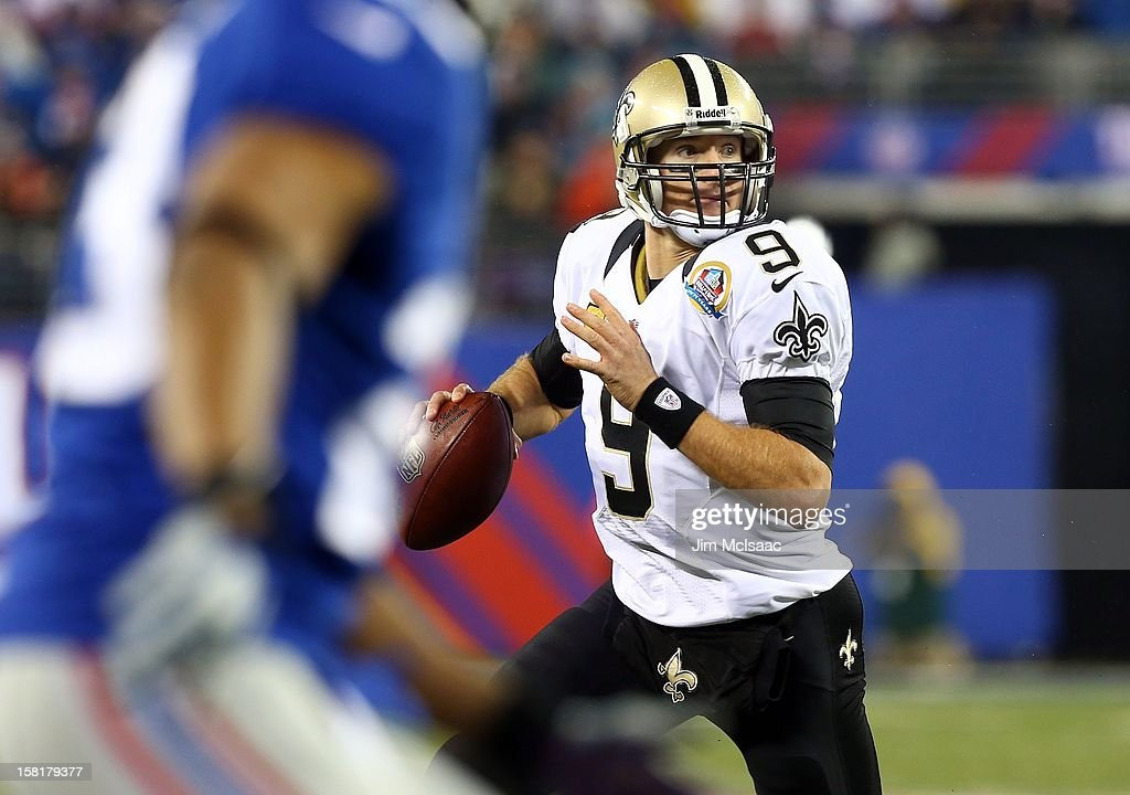 Drew Brees #9 of the New Orleans Saints in action against the New York Giants at MetLife Stadium on December 9, 2012 in East Rutherford, New Jersey. The Giants defeated the Saints 52-27.
