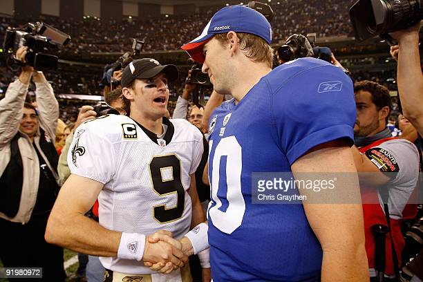 Drew Brees of the New Orleans Saints is congratulated by Eli Manning of the New York Giants after the Saints defeated the Giants 4827 at the...