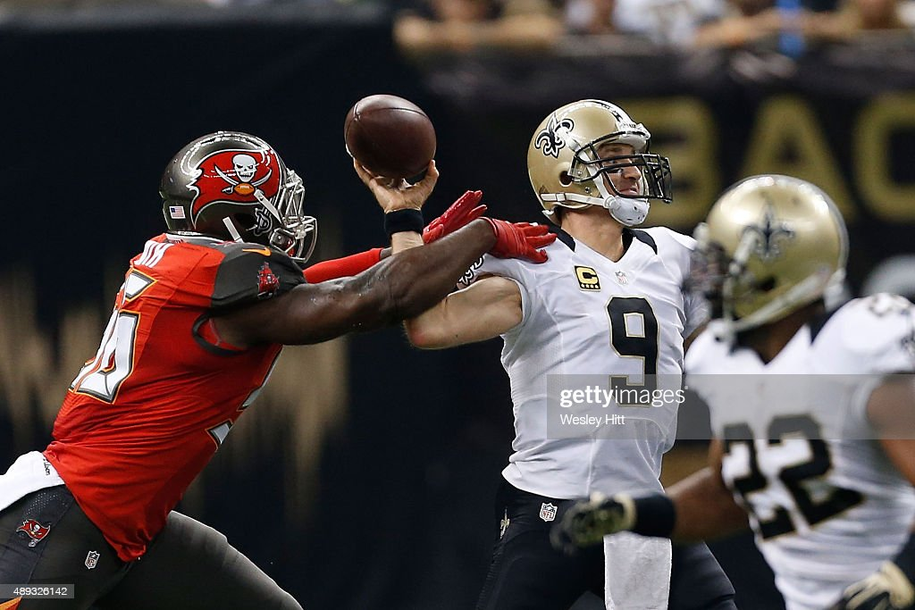 <a gi-track='captionPersonalityLinkClicked' href=/galleries/search?phrase=Drew+Brees&family=editorial&specificpeople=202562 ng-click='$event.stopPropagation()'>Drew Brees</a> #9 of the New Orleans Saints is hit by <a gi-track='captionPersonalityLinkClicked' href=/galleries/search?phrase=Jacquies+Smith&family=editorial&specificpeople=5527838 ng-click='$event.stopPropagation()'>Jacquies Smith</a> #56 of the Tampa Bay Buccaneers during the first quarter of a game at the Mercedes-Benz Superdome on September 20, 2015 in New Orleans, Louisiana.