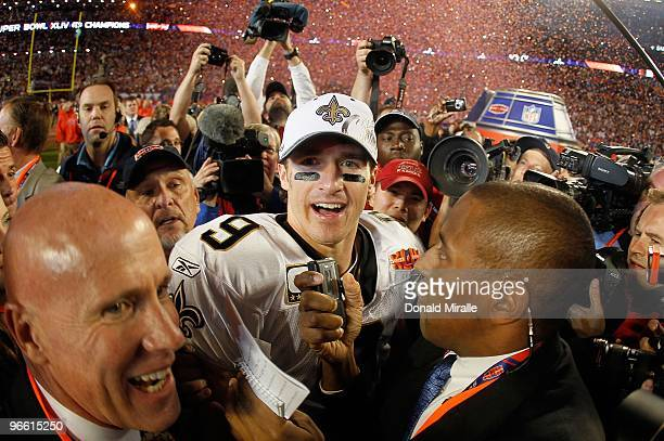 Drew Brees of the New Orleans Saints is interviewed on the field after his team defeated the Indianapolis Colts during Super Bowl XLIV on February 7...