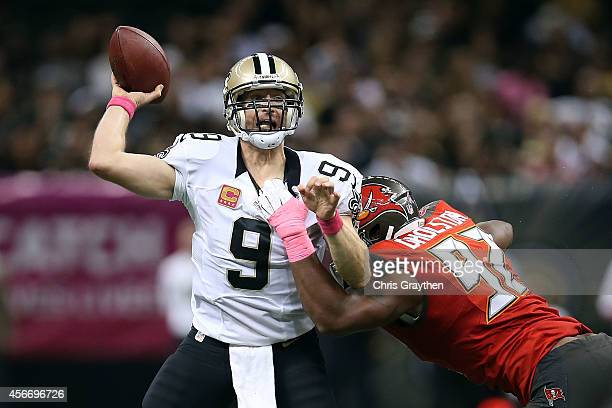 Drew Brees of the New Orleans Saints is pressured by William Gholston of the Tampa Bay Buccaneers during the fourth quarter of a game at the...