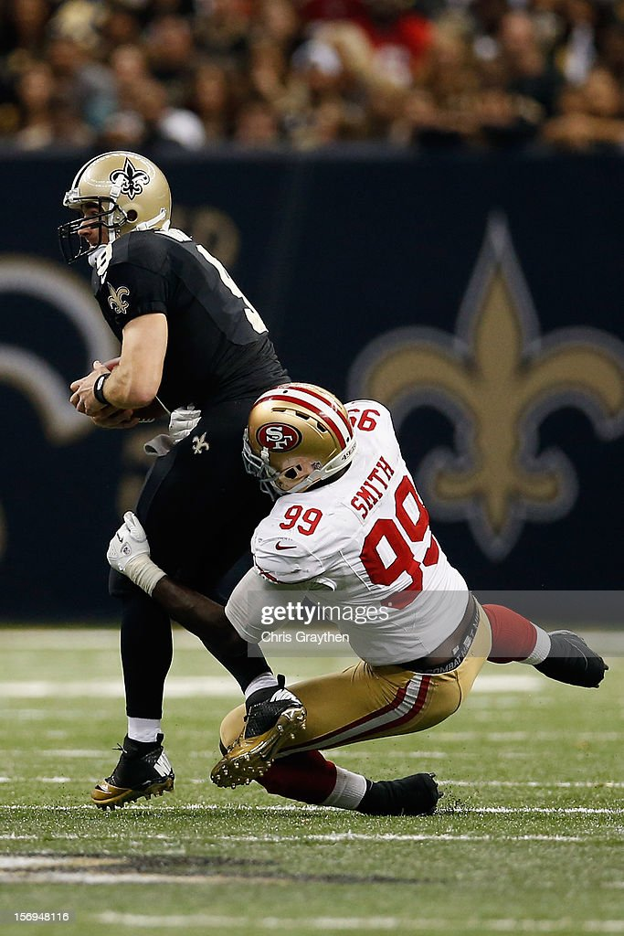 Drew Brees #9 of the New Orleans Saints is sacked by Aldon Smith #99 of the San Francisco 49ers at The Mercedes-Benz Superdome on November 25, 2012 in New Orleans, Louisiana.
