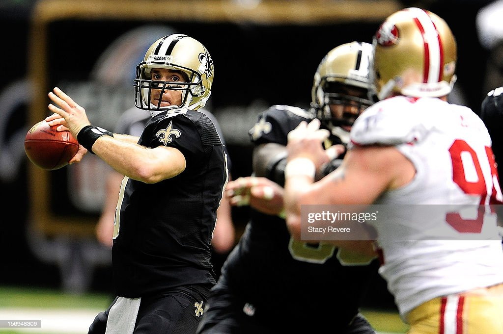 Drew Brees #9 of the New Orleans Saints looks for a receiver during a game against the San Francisco 49ers at the Mercedes-Benz Superdome on November 25, 2012 in New Orleans, Louisiana.