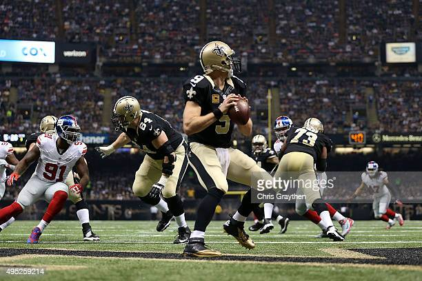 Drew Brees of the New Orleans Saints looks to pass during the first quarter of a game against the New York Giants at the MercedesBenz Superdome on...