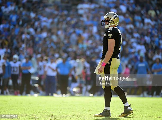 Drew Brees of the New Orleans Saints looks up at the clock trailing the San Diego Chargers during the fourth quarter at Qualcomm Stadium on October 2...