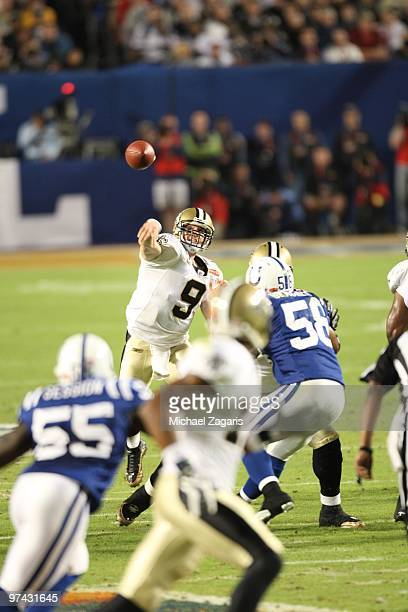 Drew Brees of the New Orleans Saints passes the ball during Super Bowl XLIV against the Indianapolis Colts at Sun Life Stadium on February 7 2010 in...